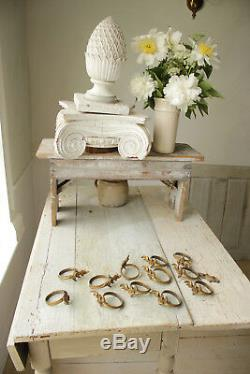 12 Antique French brass curtain rings, one escutcheon 1890 beautiful solid set