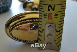 Vintage solid brass oval door knobs set with spindle and oval backplates (01C)